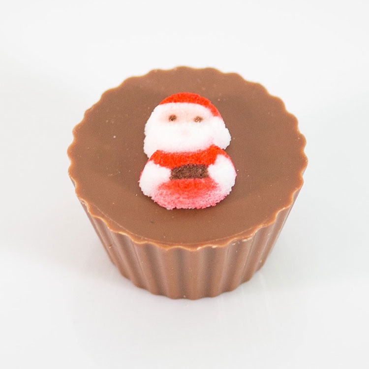 milk chocolate peanut butter cup with santa topper