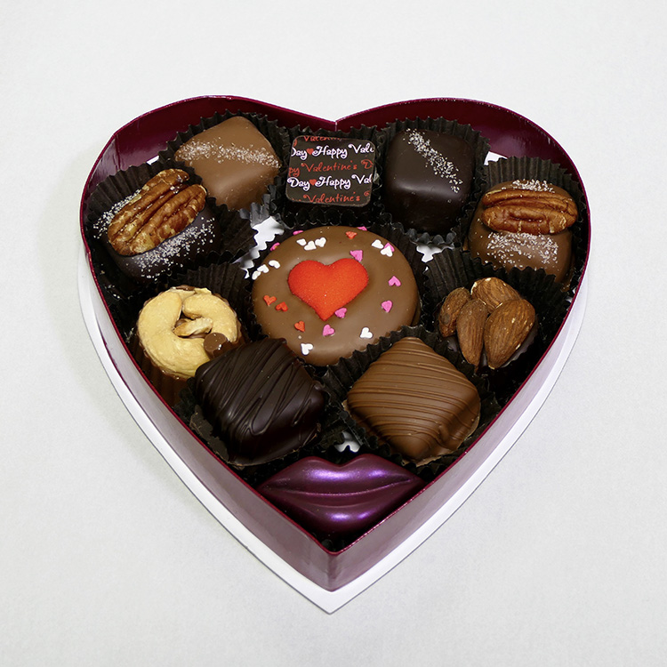 purple heart-shaped box of Valentine chocolates